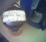 """Kaffeedose mit der Aufschrift """"Grow up to be wild"""""""